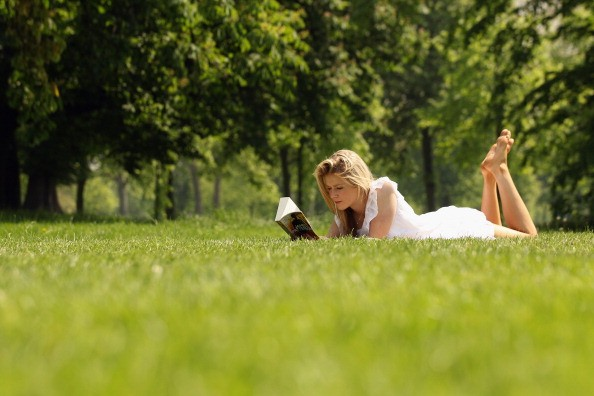 LONDON, ENGLAND - MAY 23: Breeze Burgess reads her book in the sunshine in Hyde Park on May 23, 2012 in London, England. Following the high afternoon temperatures in the capital yesterday, it is expected to reach 26 degrees Celsius today with warm weather forecast for the rest of the week. (Photo by Oli Scarff/Getty Images)