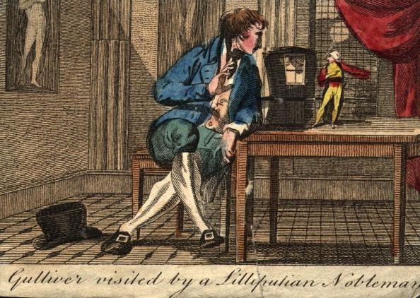 circa 1850: An illustration from Jonathan Swift's book 'Gullivers Travels' captioned: 'Gulliver visited by a Lilliputian Noble', with Gulliver looking at one of the Lilliputians on a table. (Photo by Hulton Archive/Getty Images)